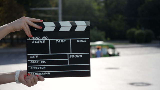 female hands holding a clapper board - film slate stock videos & royalty-free footage