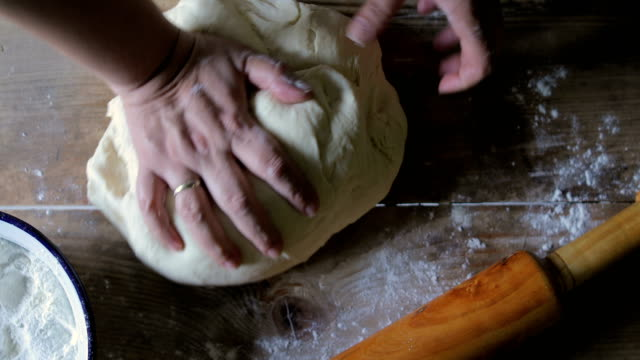 female hands making bread dough on wooden table - dough stock videos & royalty-free footage