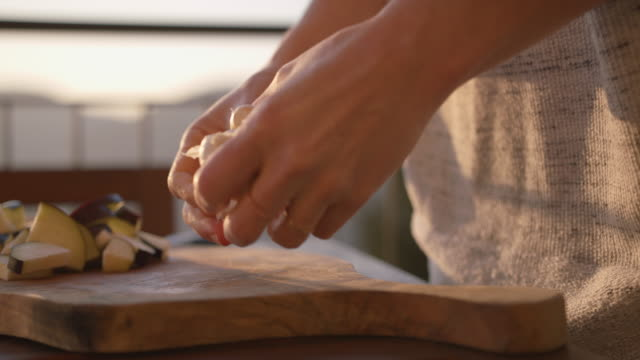 female hands pealing garlic - one mid adult woman only stock videos & royalty-free footage