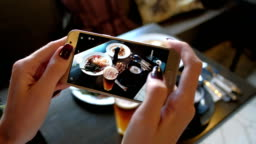 Female hands photographing food by smartphone