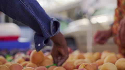 cu female hands select fruit at farmers market - santa barbara california stock videos & royalty-free footage