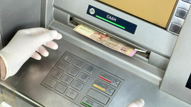 female hands take money from an atm. - ukraine stock videos & royalty-free footage