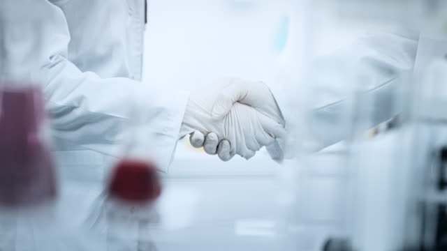 female handshake in the laboratory - partnership teamwork stock videos & royalty-free footage