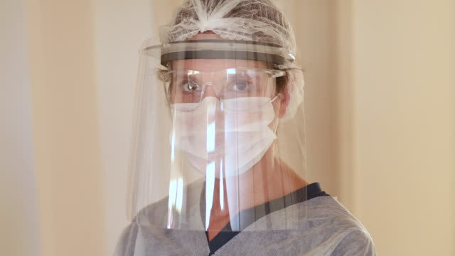 female health care worker - protective workwear stock videos & royalty-free footage