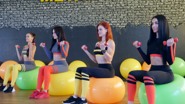 female  health club members following healthy lifestyle working out in modern studio - four people stock videos & royalty-free footage
