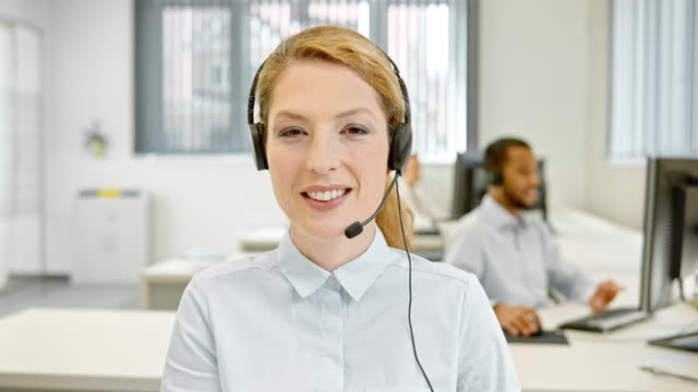 ld female helpline operator on a video call with customer - headset stock videos & royalty-free footage