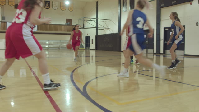 female high school basketball players competing in a game - secondary school stock videos & royalty-free footage