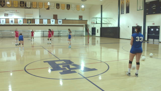 female high school volleyball players competing in a game - volleyball sport stock videos and b-roll footage