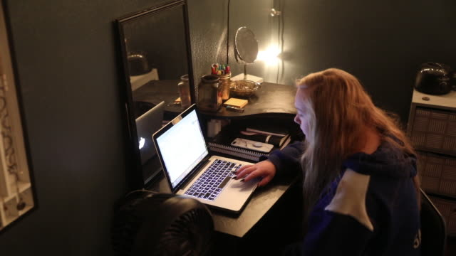 female highschool student sitting with laptop in her bedroom and participating in a live lecture during a remote learning class in princeton illinois... - female high school student stock videos & royalty-free footage