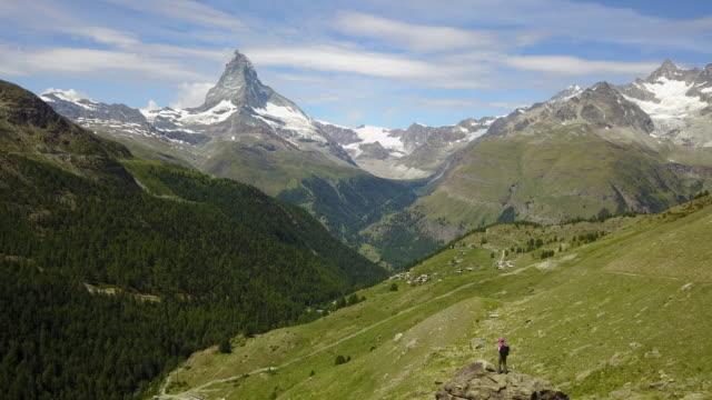 Female hiker admires the Matterhorn