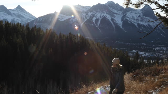 female hiker ascends mountain trail at sunrise - alberta stock videos & royalty-free footage