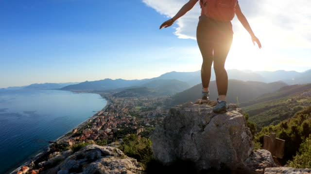 female hiker jumps between rocks at sunrise - discovery stock videos & royalty-free footage