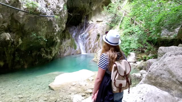 female hiker looking at waterfall - yosemite national park stock videos and b-roll footage