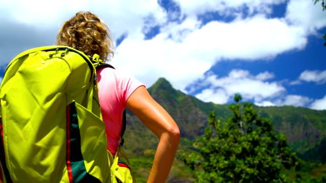 female hiker rainforest volcanic island hiva oa marquesas - französisch polynesien stock-videos und b-roll-filmmaterial