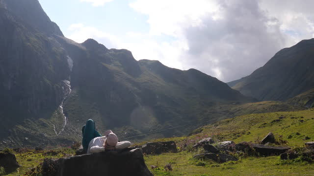 female hiker relaxes in mountain meadow - lying on back stock videos & royalty-free footage