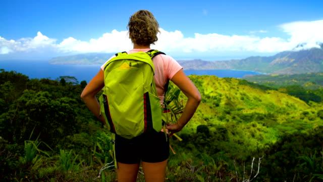 female hiker scenic coastline nahoe mountains hiva oa - französisch polynesien stock-videos und b-roll-filmmaterial
