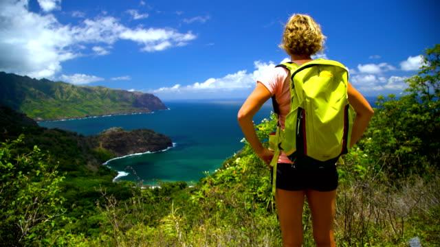 female hiker scenic coastline nahoe mountains hiva oa - polynesian ethnicity stock videos & royalty-free footage