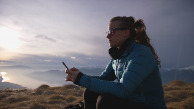 female hiker using smartphone on top of mountain - mobile phone stock videos & royalty-free footage