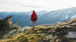 Female hiker walking towards camera