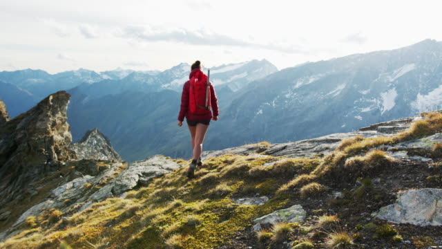 female hiker walking towards camera - austria video stock e b–roll