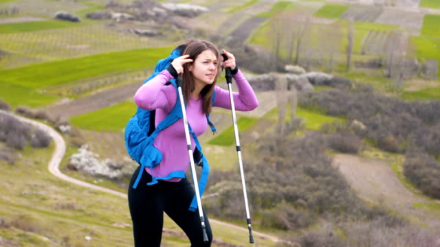 female hiking on the mountain ridge - hiking pole stock videos and b-roll footage
