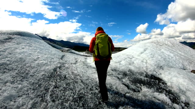 pov female hiking over moraine covered melting ice - rubble stock videos & royalty-free footage