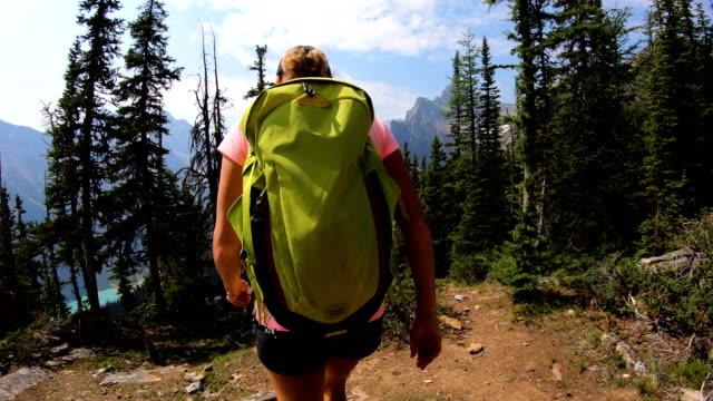 POV female hiking turquoise lake water British Columbia