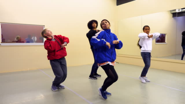 MS Female hip hop dance group practicing in dance studio