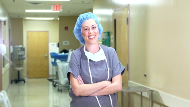 female hispanic scrub nurse or doctor - female nurse stock videos & royalty-free footage
