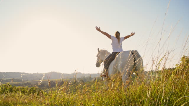 SLO MO Female horse rider enjoys the freedom in nature
