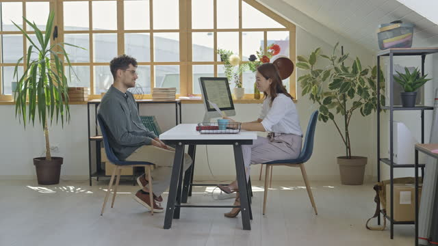 female hr interviewing young man for new position on work - business casual stock videos & royalty-free footage