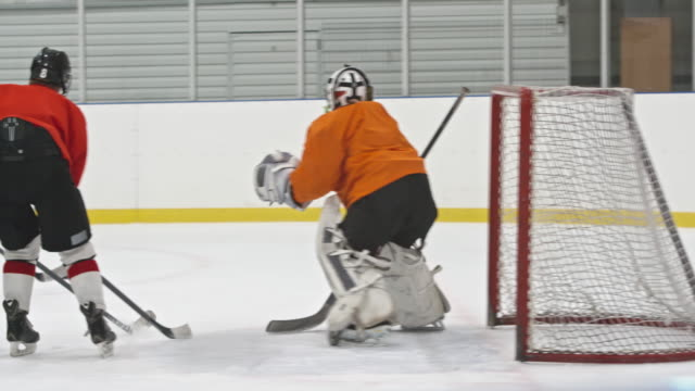 female ice hockey forward failing to score goal - hockey glove stock videos & royalty-free footage