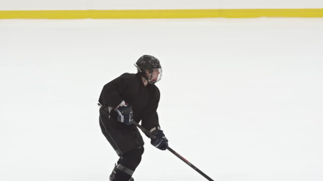 female ice hockey forward shooting for goal and scoring - hockey glove stock videos & royalty-free footage