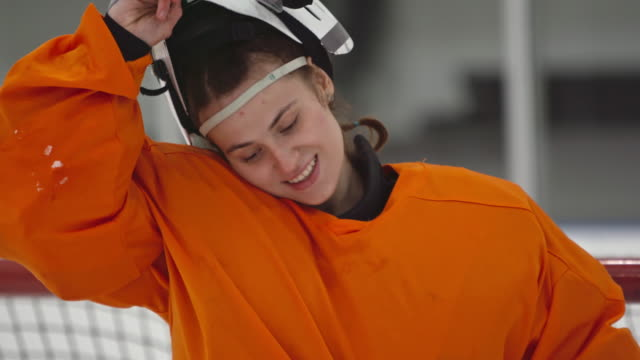 female ice hockey goalie posing for camera - removing stock videos & royalty-free footage