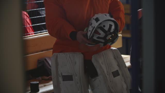 female ice hockey goalie putting protective helmet on - goalkeeper stock videos & royalty-free footage