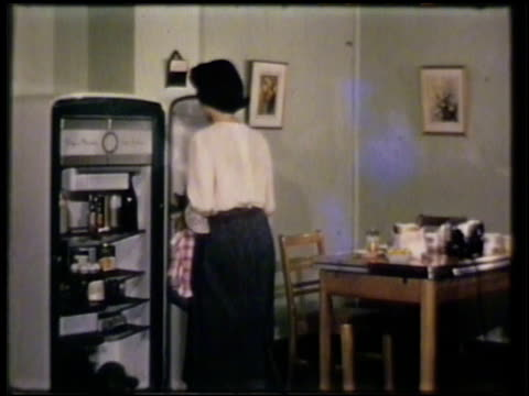 female in kitchen opening refrigerator. rubber welt, seal, around fridge door. female hands putting bread in toaster slots. rubber insulator of... - stay at home mother stock videos & royalty-free footage