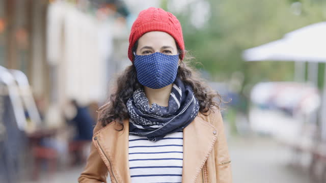 female in protective face mask on footpath in city - headshot stock videos & royalty-free footage