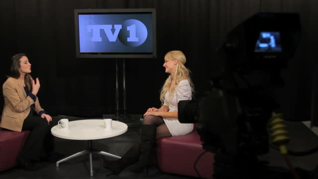 female in studio interview guest - media interview stock videos and b-roll footage