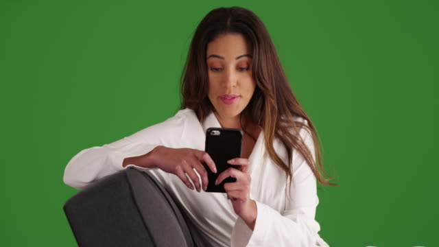 female in white bathrobe lounging on sofa, texting someone on green screen - psychiatrist's couch stock videos & royalty-free footage