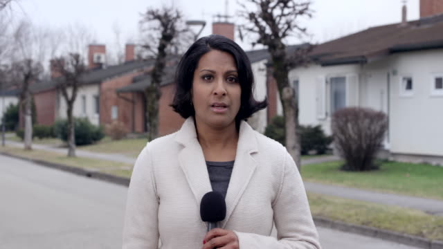 Female Indian reporter reporting live from the field
