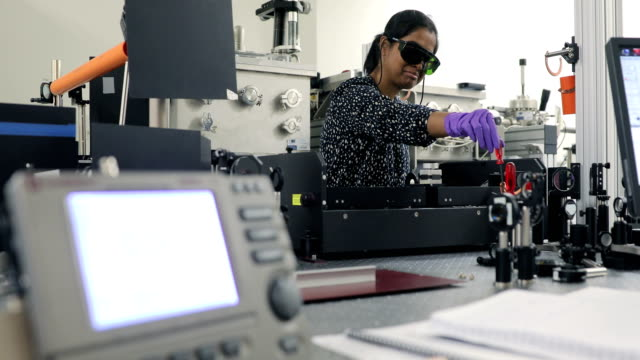 Female Indian Researcher Maintaining Powerful High Frequency Laser in Laboratory