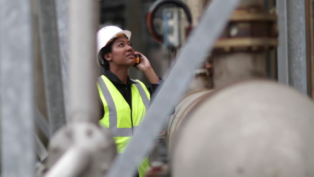 female industrial worker using radio on site - construction site stock videos & royalty-free footage