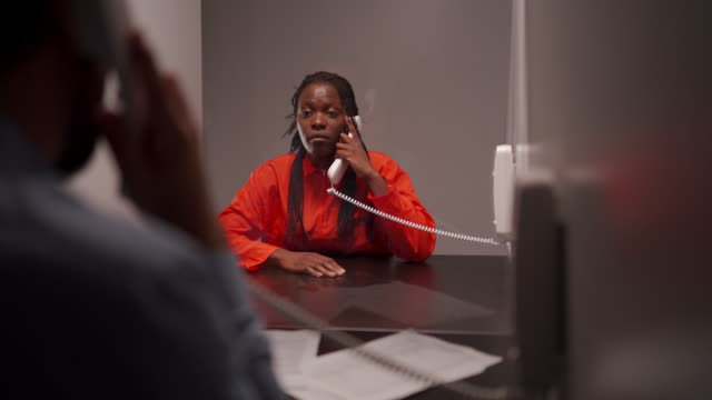 female inmate talking with her lawyer in prison visit room - prosecutor stock videos & royalty-free footage