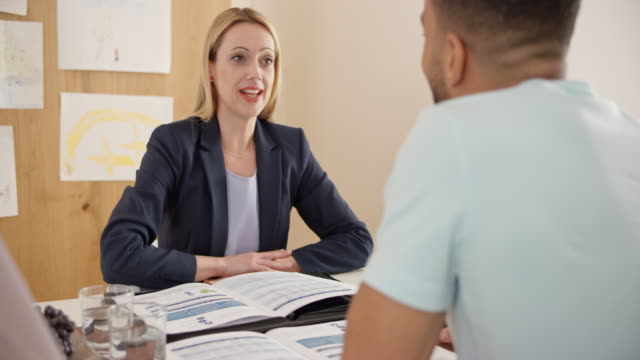 Female insurance agent advising a client at home