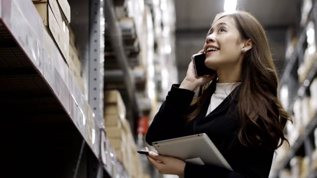 female inventory manager checks stock ,parcels, packages ready for shipment. - shop assistant stock videos & royalty-free footage