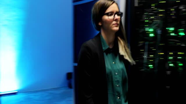 Female IT Engineer Checking on Server Room