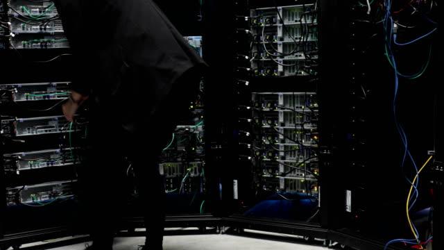 Female IT Engineer Working in Server Room