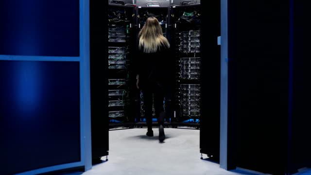 female it engineer working in server room - server room stock videos & royalty-free footage
