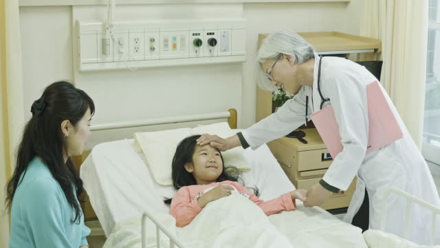 female japanese doctor meeting with mother and child patient - medical procedure stock videos & royalty-free footage