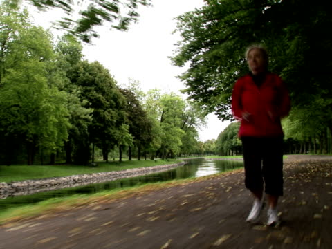 a female jogger stockholm sweden. - only mature women stock videos & royalty-free footage